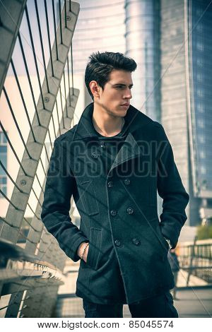 Stylish Young Man In Black Coat In City Center Street