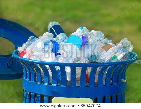 Trash bin full of beverage empty bottles in summer thirsty day