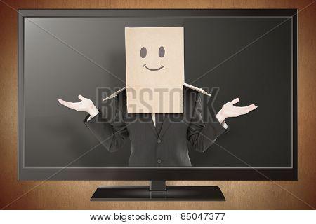 Businessman shrugging with box on head against orange vignette