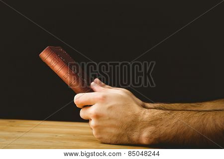 Man praying with his bible on wooden table