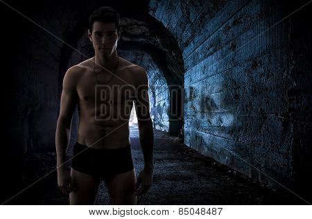 Muscular Man Wearing Underwear In An Old Tunnel