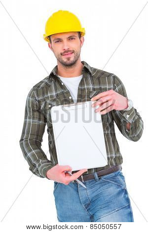 smiling manual worker holding clipboard on white background