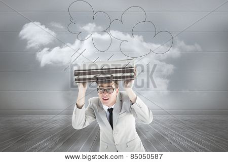 Geeky businessman holding his briefcase over head against clouds in a room