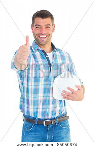 Portrait of confident manual worker gesturing thumbs up on white background