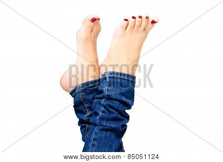 Female groomed feet in jeans