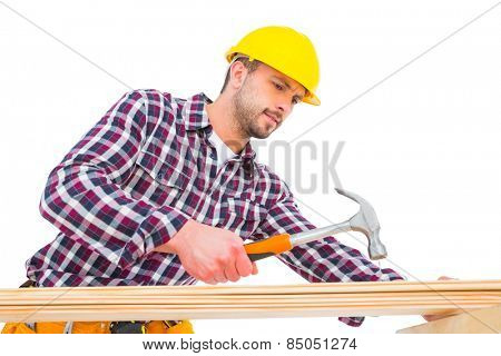 Handyman using hammer on wood on white background