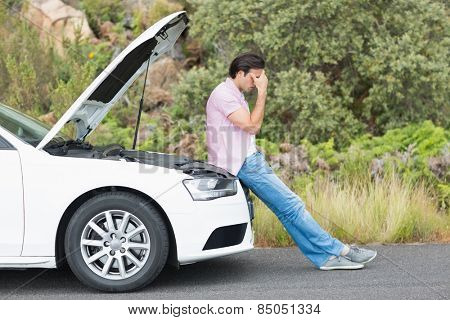 Desperate man after a car breakdown at the side of the road