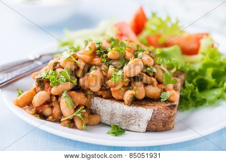 Stewed White Beans In Tomato Sauce On Toasted Bread