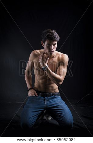 Handsome Muscular Shirtless Young Man Kneeling Down On The Floor