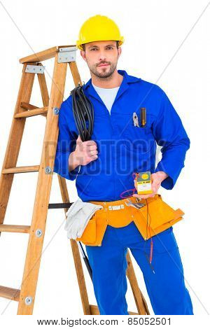 Electrician holding cables and multimeter on white background