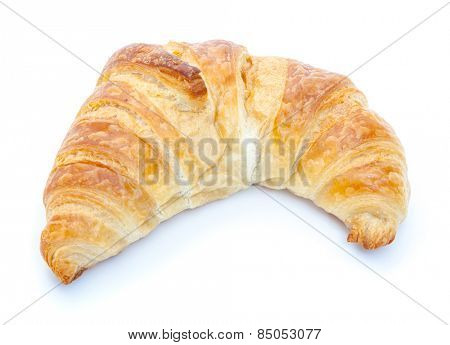 Freshly baked croissant. All on white background.