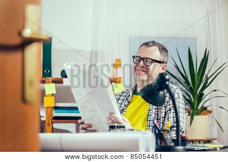 Designer working at the office.  Selective focus. Small business owner