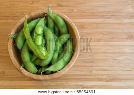 Japanese green soy bean on the wooden table.