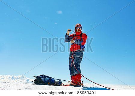 climber at the top of a pass