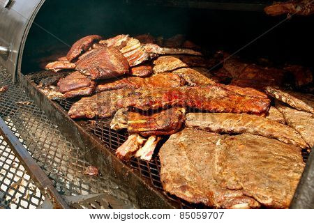 Slabs Of Ribs Cook Inside Industrial Grill At Festival
