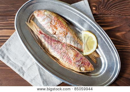fried red mullet on the oval dish