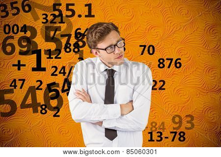 Young businessman thinking with arms crossed against yellow background with vignette