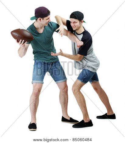 Two handsome young men playing with ball isolated on white