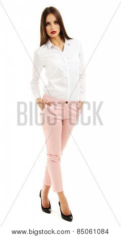 Beautiful model in white shirt and pink pats isolated on white