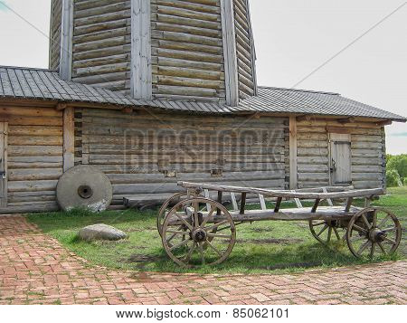 Wooden waggon near windmill