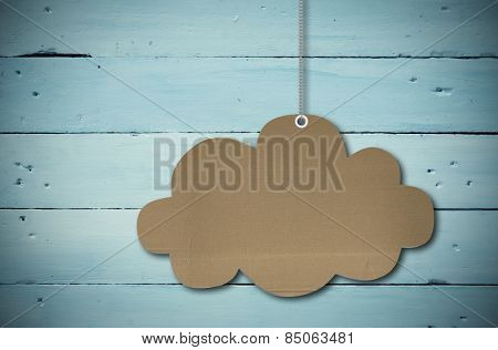 Hanging cloud tag against painted blue wooden planks