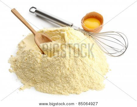 Heap of cornmeal with egg and corolla isolated on white