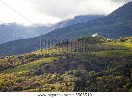 Hillside vineyards with white house in Crimea