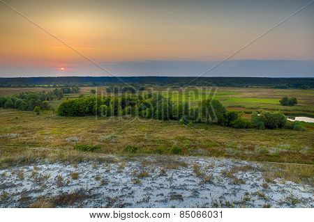 Dawn over the steppe field