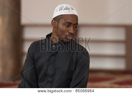 Young African Muslim Guy Praying