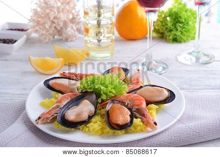 Seafood Paella on plate on table close-up