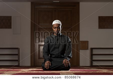 African Muslim Man Is Praying In The Mosque