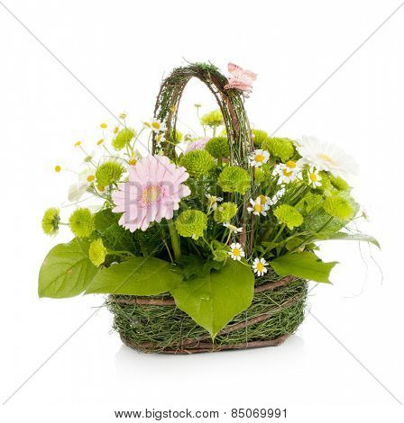 Bouquet of flowers in basket with butterfly. Isolated on white background