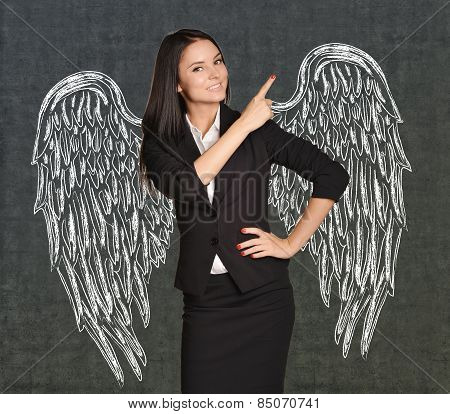 Angel girl with wings painted on the wall