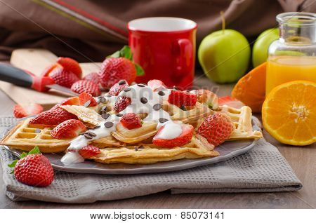 Homemade Waffles With Maple Syrup And Strawberries