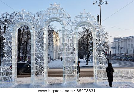 YEKATERINBURG, RUSSIA - JANUARY 2, 2015: People near the gate to the ice town on the Square of 1905. Municipality paid 18,9 millions rubles for the construction of ice town for Christmas celebrations