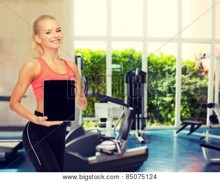 fitness, dieting, technology and sport concept - smiling sporty woman showing tablet pc blank black screen