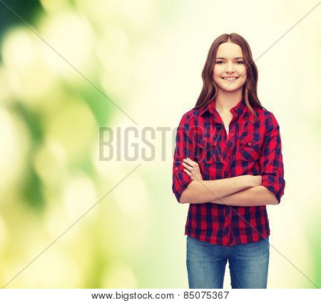 happy people concept - happiness and people concept - smiling young woman in casual clothes with crossed arms