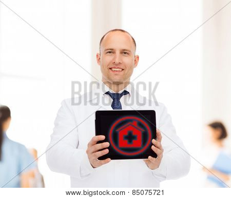medicine, profession, and healthcare concept - smiling male doctor with tablet pc computer over group of medics