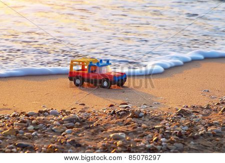 Toy on sea shore. Nature conceptual composition.