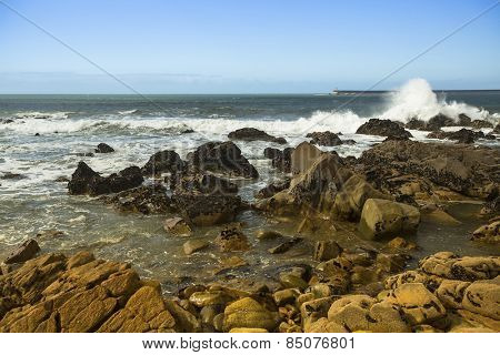 Surf at rocky ocean coast. Atlantic ocean, Portugal.