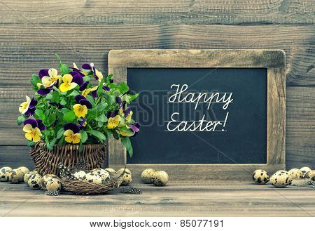 Easter Decoration Eggs, Pansy Flowers And Vintage Blackboard
