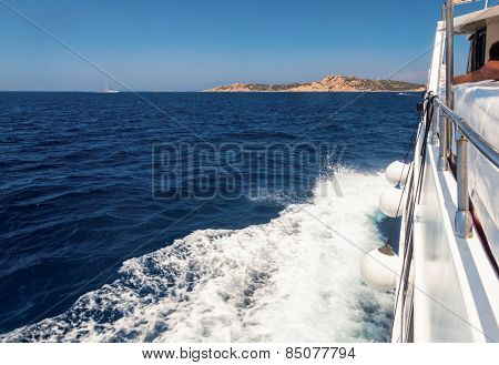 Pleasure boat cruising in the sea
