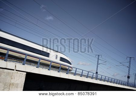 view of a high-speed train crossing a viaduct in Sagides, Soria, Castilla Leon, Spain.