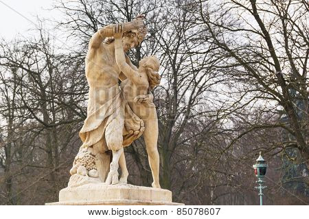 Statue of nymph catching grapes from satyr's hand in Lazienki park (Royal Baths park), Warsaw, Poland