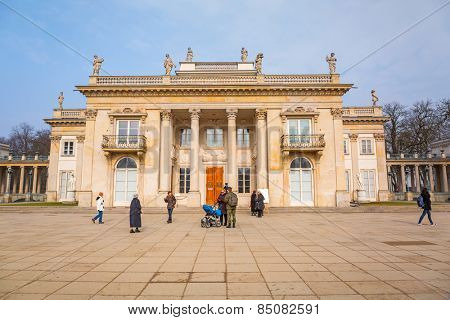 WARSAW, POLAND - MARCH 1, 2015: People walking in Royal Baths garden at the Palace on the Water, Warsaw, Poland. Palace was summer residence of the last Polish King Stanislaus Augustus Poniatowski.