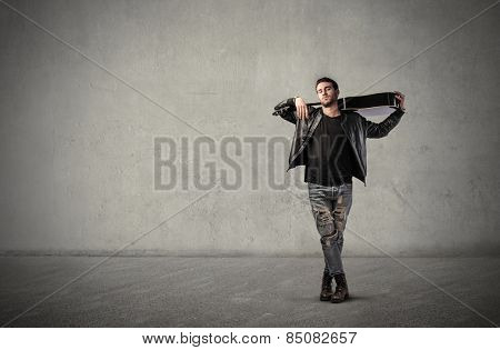 Guitarist posing for a picture
