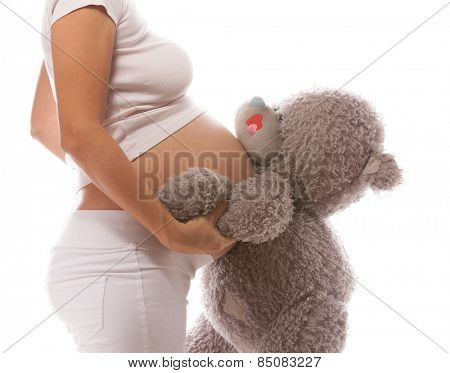 pregnant caucasian woman closeup body isolated on white background studio shot belly orange fruits healthy eating citrus diet
