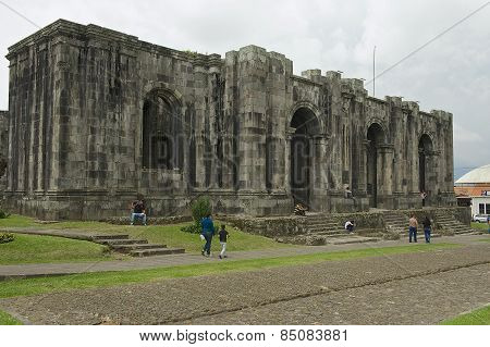 People pass the ruins of the Santiago Apostol cathedral in Cartago, Costa Rica.