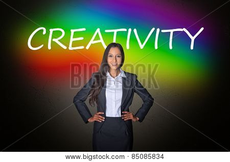 Young Female Executive in Front a Conceptual Colorful Background Design, Emphasizing Creativity.