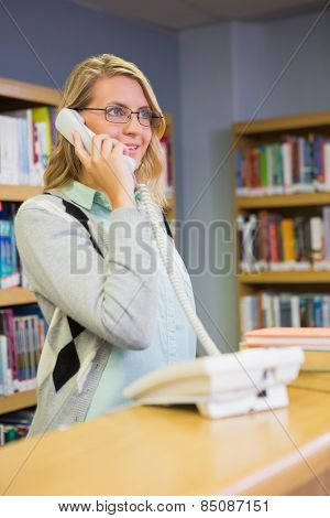 Pretty librarian answering the phone at the university